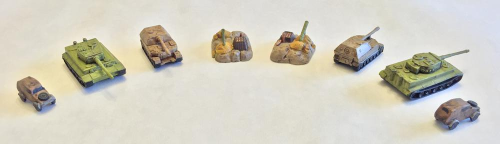 4 painted Memoir '44 miniatures from two angles each, having been washed with darker colors to bring out the detail.