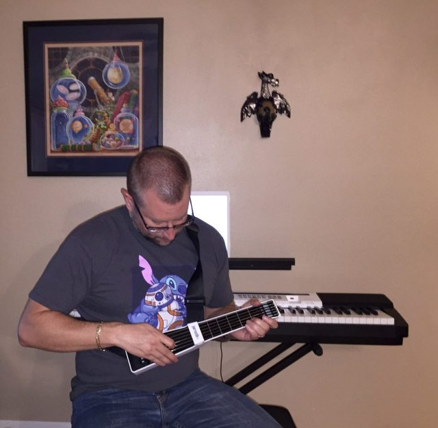 Plucking away with the Jamstik+ (Photo by Nora Owens)