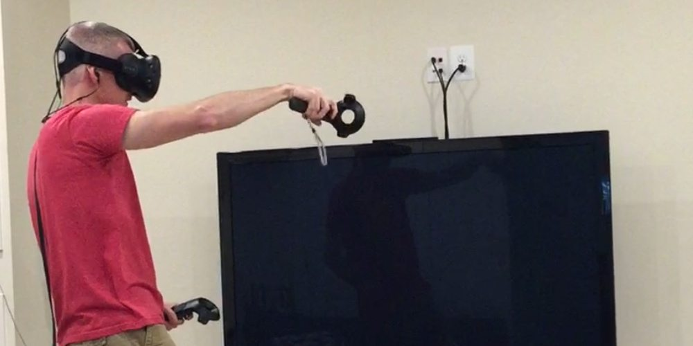 Mike wearing a Vive and aiming his hands in virtual space.