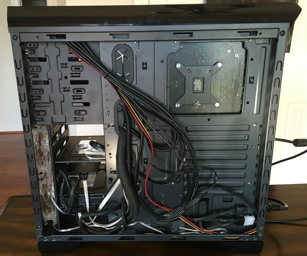 The back of a PC tower with cables routed haphazardly.
