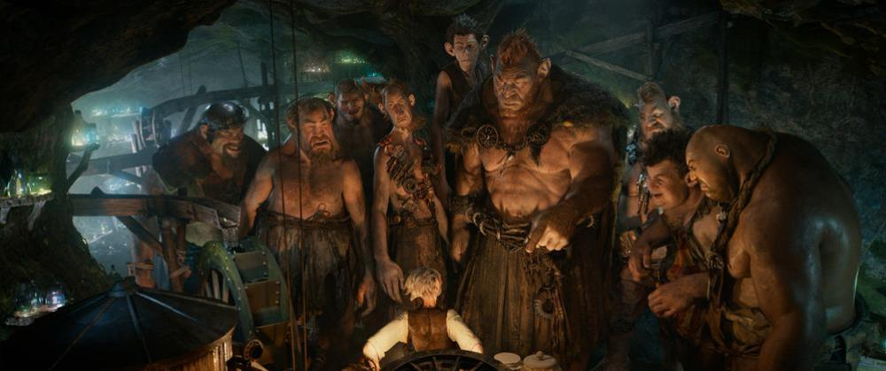 (Left to right) Gizzardgulper, Childchewer, Maidmasher, Bloodbottler, Manhugger, Fleshlumpeater, Meatdripper, Butcher Boy, and Bonecruncher surround the BFG in Disney's 'The BFG'. Image © Disney