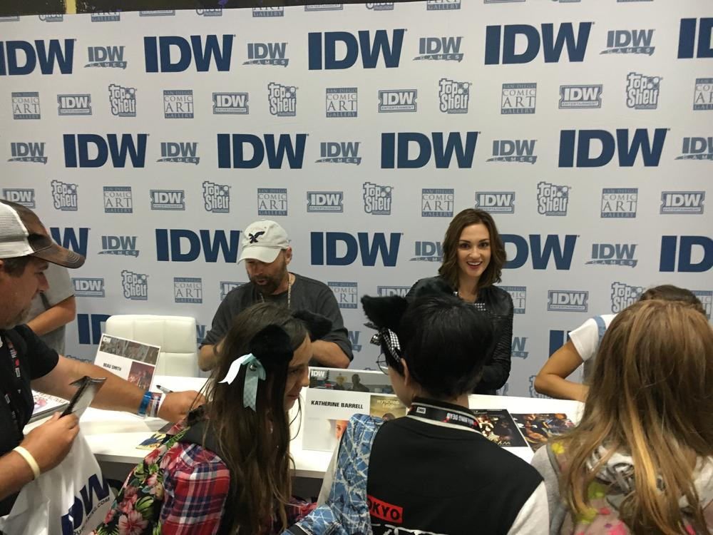 The cast of Wynonna Earp signing at the IDW booth at Comic Con.