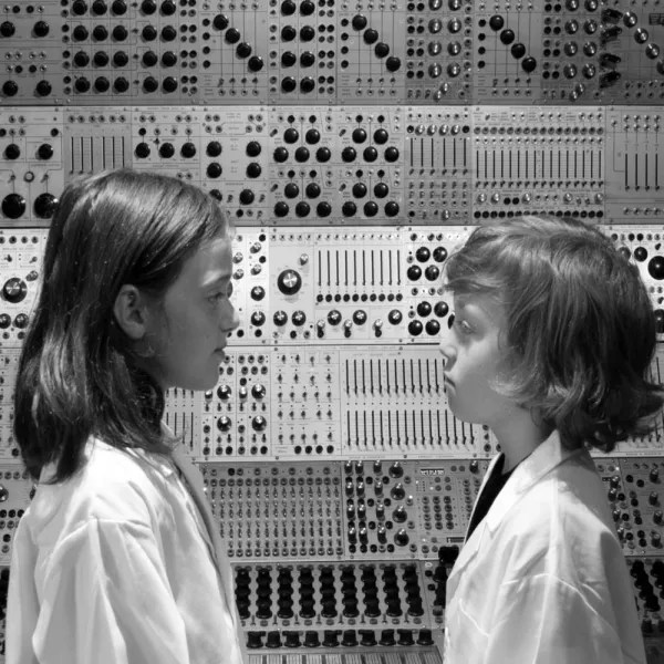 The artists' kids in front of the Buchla. Photo courtesy of VeryRecords