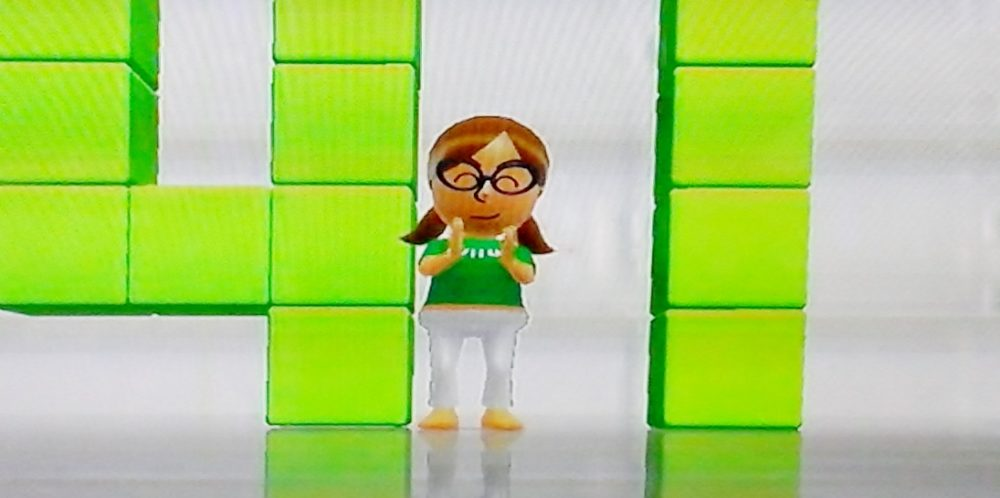 Screenshot of the author's Mii cheering on her Wii Fit progress