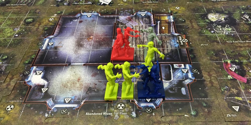 A close-up of player squads and zombies on the Zpocalypse 2 board.