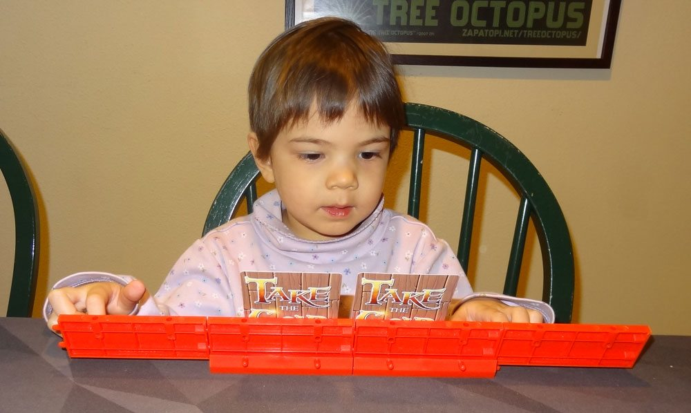 Toddler playing Take the Gold