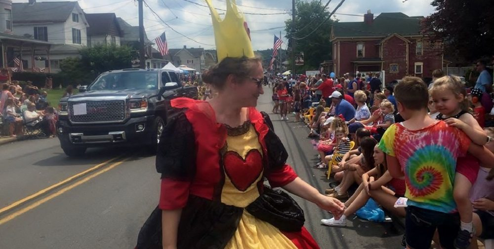 the author as the queen of hearts in a parade - first cosplay