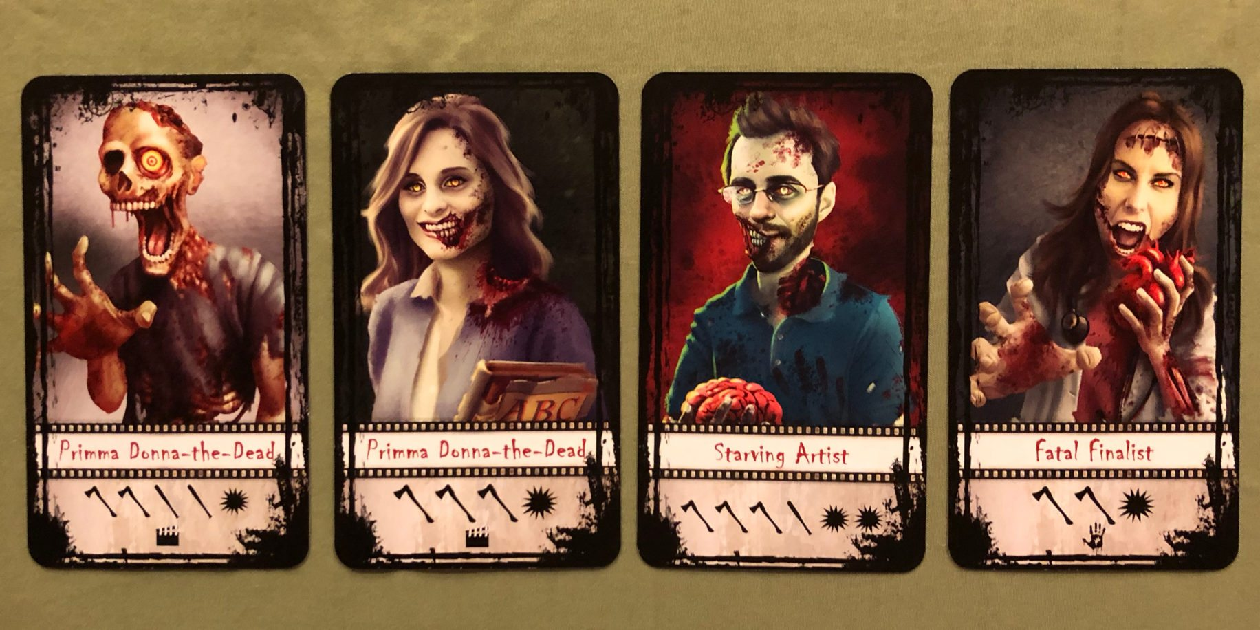 A collection of four Z-lebrity cards from 'Adventures in Zombiewood'