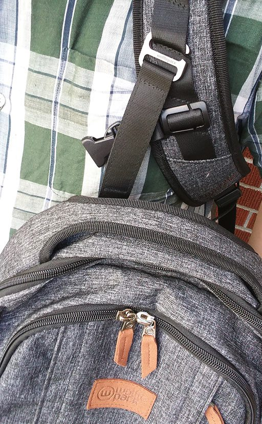 Pack attached to front of strap by metal clip