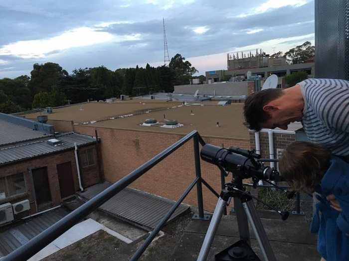 family telescope in urban area