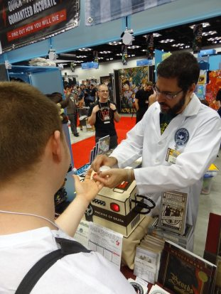David Malki takes a blood sample for the Machine of Death.