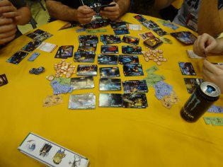 Titanium Wars, from Iello Games, pits players against each other to collect titanium and build better ships, weapons, and equipment.