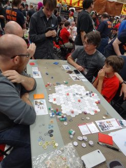 Greater Than Games announced a new spin-off, Sentinels Tactics, which will have miniatures and a hex-based board. The prototype drew crowds all weekend.