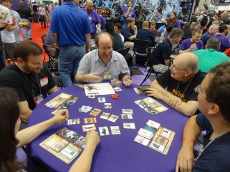 Mike Selinker runs demos of his new Pathfinder Adventure Card Game at the Paizo booth.