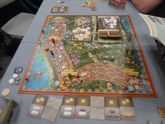 Via Appia by Queen Games has a curious structure that works like those quarter-eating games in the arcade. Put one in, shove the bar, and see if anything drops out the other side.