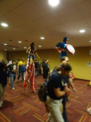The long legs of justice—Captain America and Wonder Woman stay above the crowd.