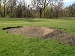 Bunker is dug out, with soil used to shape the face and mound that ties it into the surrounding terrain.