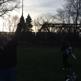 Celebration at sunset as the final shot sails over the bridge and canal.