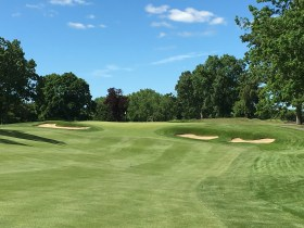 #7 - Par 4 - Approach to the green perched on the ridge