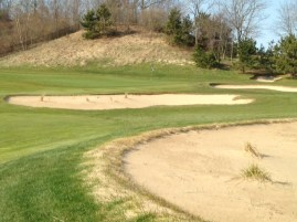 #4 - Approaching the green over the cross bunkers and waste area
