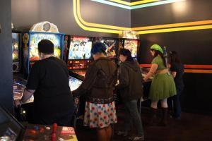 Ladies get fierce playing pinball.