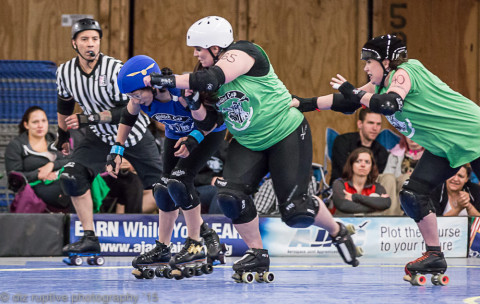 Slytherin blockers push the Ravenclaw jammer out of play.  Image source: Diz Ruptive Photography