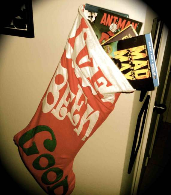 This could be hanging by your fireplace if you enter and win. Go ahead, take a chance on some Festive Fun!