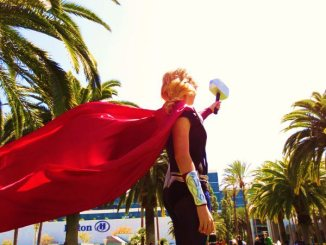 Amy wearing a cape in cosplay