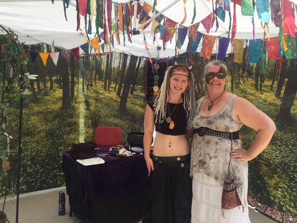 Sam and Ellen of Gaia's Gifts are blessing dice at the WCSFF Day!