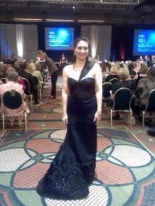 Author Barb Ferrer bid on and won this Proenza Schouler gown (originally worn by Maggie Gyllenhaal at the 2007 Oscars) at a Clothes Off Our Backs auction. She wore it the night her debut novel won a RITA award.