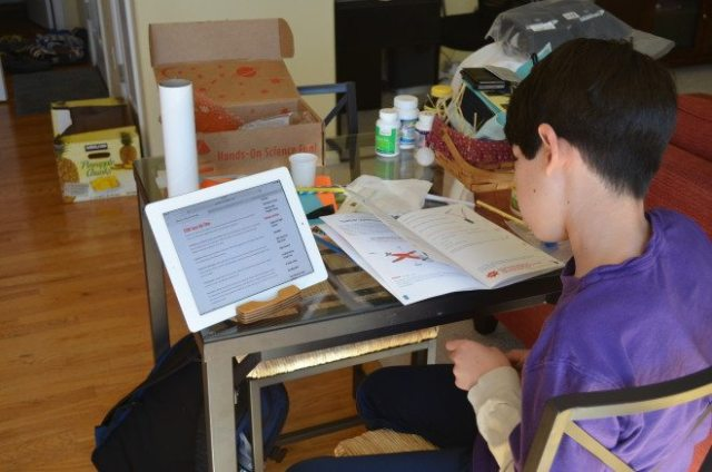 My oldest son viewing the Beyond...in a Box website while working on his parachute activity. Image: Patricia Vollmer.