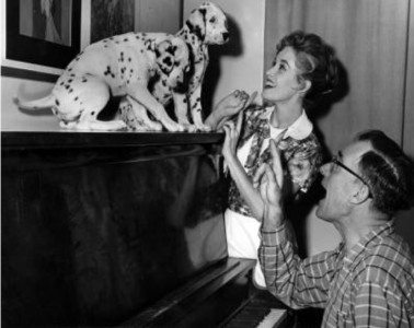 Lisa Davis gets into characterplaying with puppies before production. (Photo: Disney Studios)