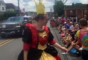 the author as the queen of hearts in a parade