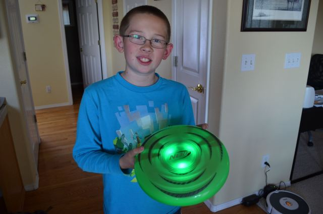 My youngest son shows off the Nerf FireVision Ignite flying disc in its well-lit glory. Photo: Patricia Vollmer.