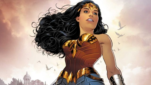Image of Wonder Woman standing, holding her lasso