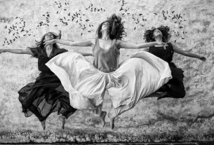 three women jumping in a row, their skirts floating around them