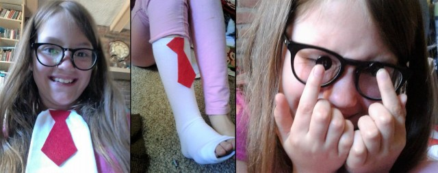Girl modeling a sock with a red tie on her chest and leg, and then holding up two black buttons to her glasses.