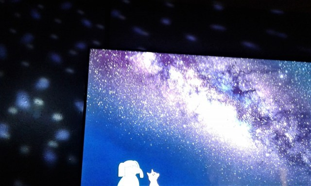 "Inside the ""Waiting"" movie room when the walls swirl with stars and a galaxy swhooshed night sky graces the screen"