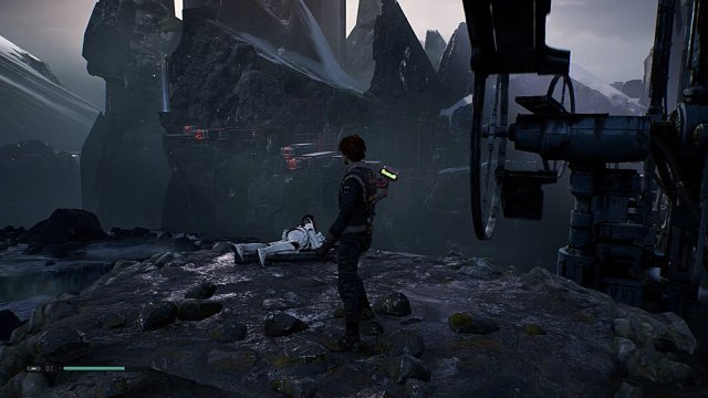 Cal and BD-1 Survey their Surroundings, a Blue Beam Indicating a Save Point can be seen on the Mountainside opposite, Screenshot: Sophie Brown