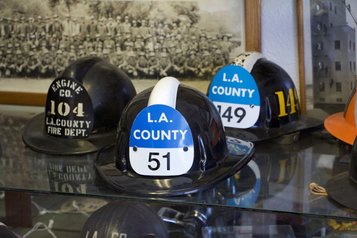 A collection of LA County Fire Department helmets.