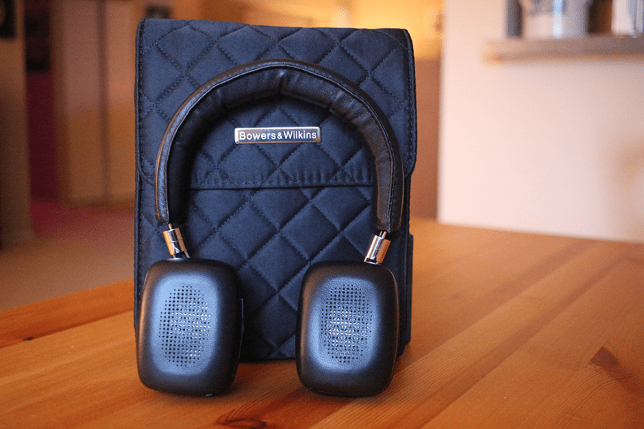 Bowers & Wilkins P5 Wireless Headphones, pad-forward view, with the included padded storage bag.