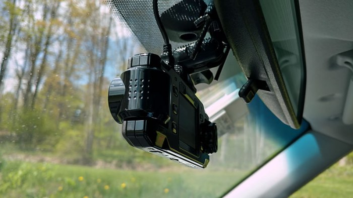 Dash cam attached to mirror mount, side view