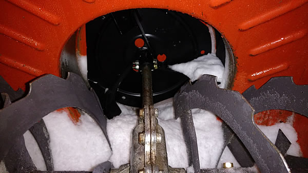 A nice, new impeller installed in the snow blower, with snow on it