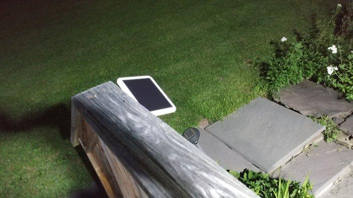 Solar panel mounted on porch railing
