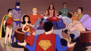 Super Friends meeting around a table