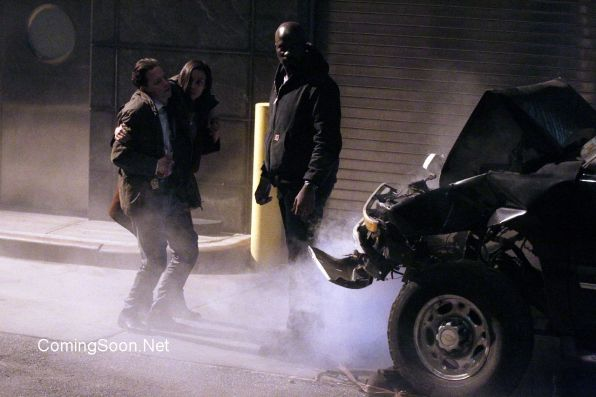 """NEW YORK, NY - DECEMBER 02: Mike Colter, Frank Whaley, Rosario Dawson. In this scene Whaley's character , a policeman, gets killed filming """"Marvel / Netflix's """"Luke Cage"""" on December 2, 2015 in New York City. (Photo by Steve Sands/GC Image"""