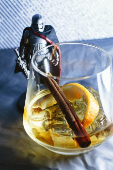 """Old Fashioned Phasma"" - Galactic Riot Control requires a boots-first, ask-questions-never kind of approach, and the Old Fashioned Phasma delivers the same kind of butt kicking as its namesake. 3 oz - Usquaebach Reserve Scotch Whisky 1 oz - Almond Orgeat 3 dash - Orange Bitters Grated Cinnamon Stick Stir all ingredients. Strain. Serve over rocks, garnish orange peel."