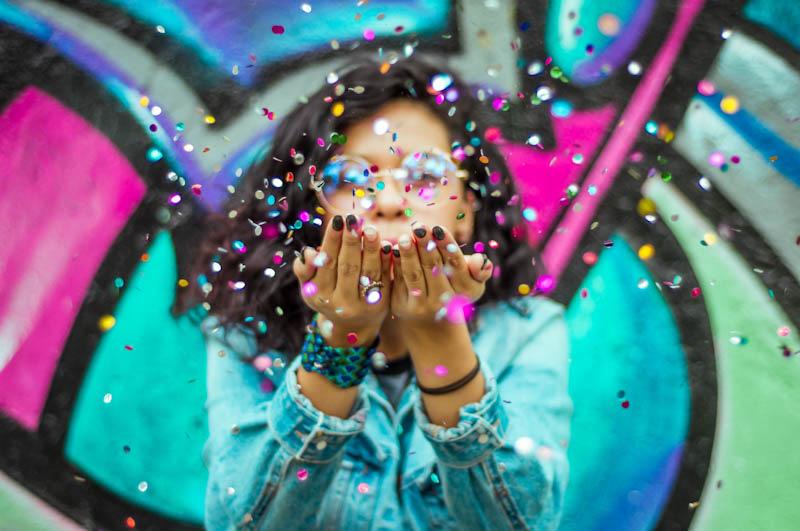 Woman blowing confetti
