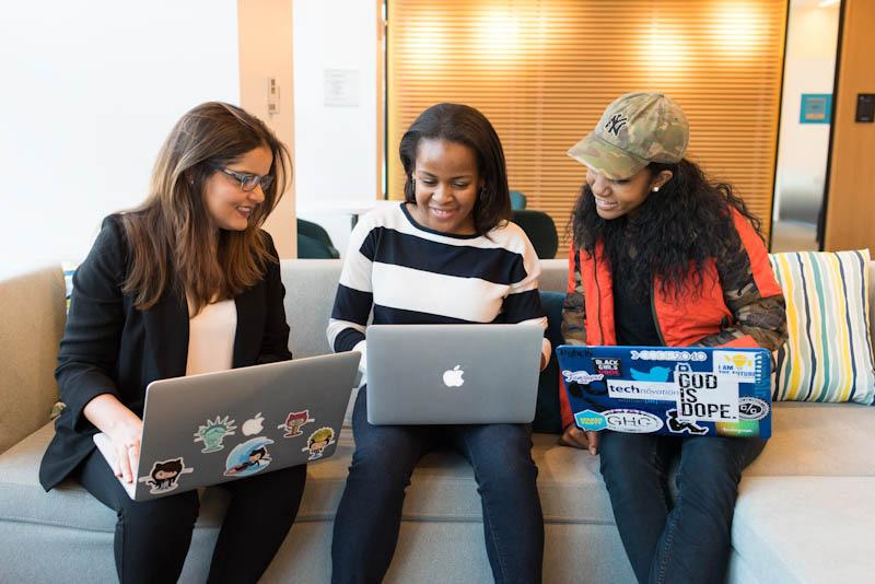 Three women looking at their laptop