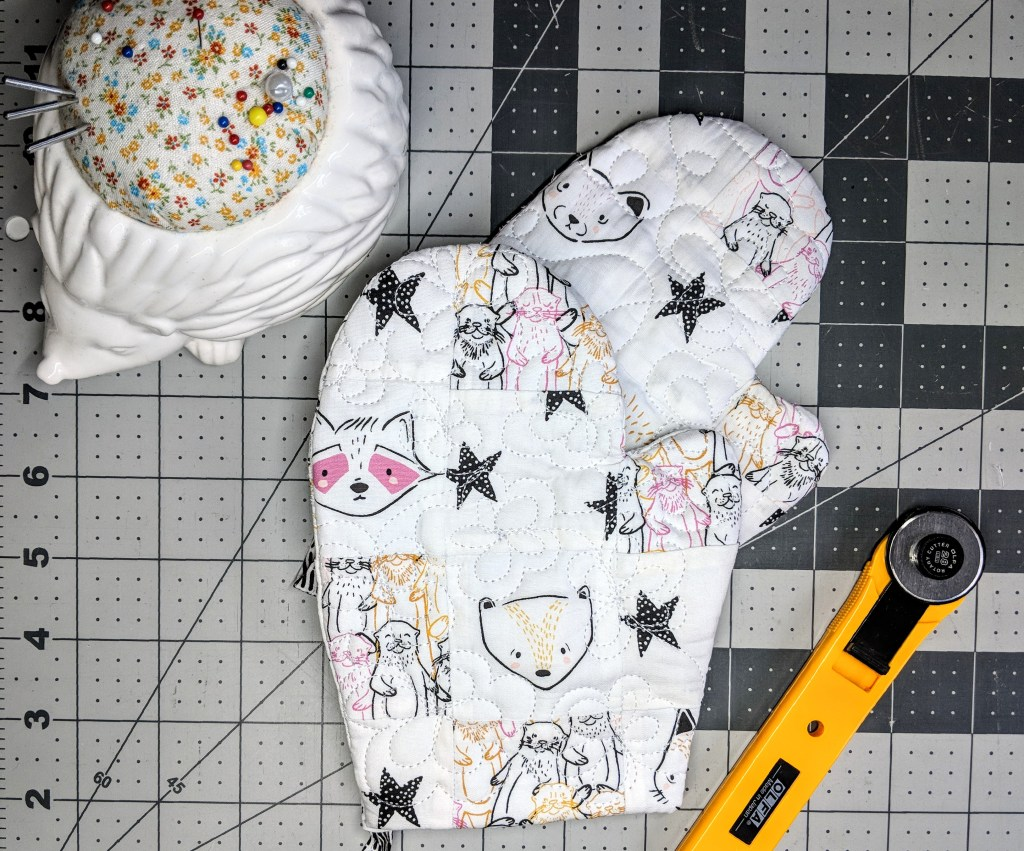 A quick pair of toddler oven mitts makes a perfect gift, and uses up batting scraps!
